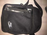 All black small items Nike bag
