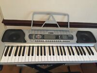 Acoustic Solutions electric keyboard, stand and seat.