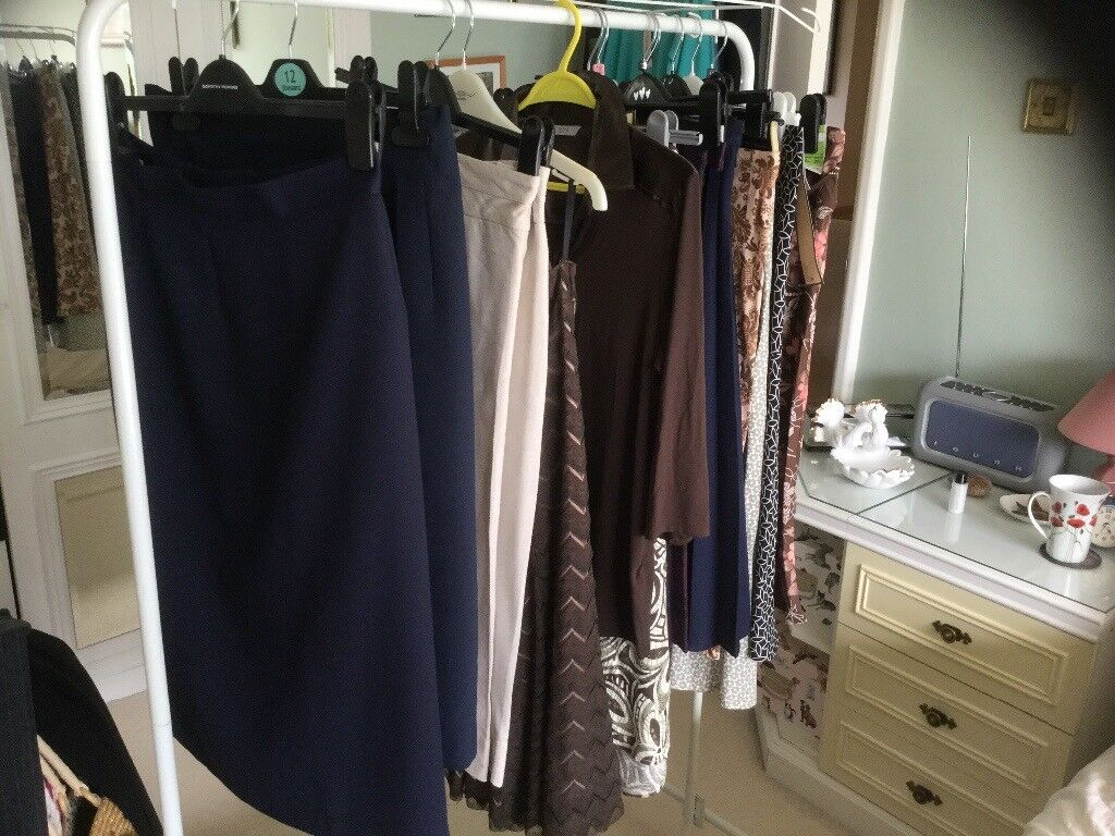 Ladies skirts and tops some never worn mostly M&S size 12 and 14