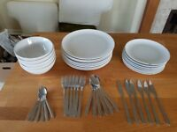 Ikea white bowls and plates with cutlery