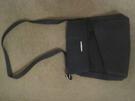 Medium sized black bag with adjustable strap (for length).