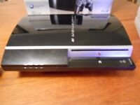 PS3 Console (in original box) plus 8 games in immaculate condition