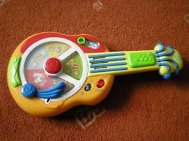 Leap Frog interactive toy guitar with English and French settings. In excellent condition.