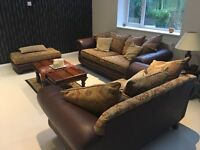 Sofa suite -a mix of leather and fabric 3seater,2Seater and a footstool.excellent condition