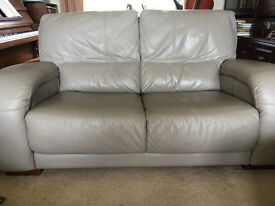3 light grey leather sofas with matching storage footstool