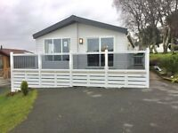 Stunning luxury 2 bedroom twin unit lodge for sale beautiful seaside holiday park in Wales