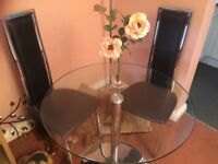 STUNNING GLASS TABLE AND CHAIRS