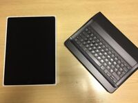 iPad Pro (12.9-inch) 128GB + Logitech Keyboard Case w/ Smart Connector.