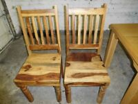 Solid wood cottage dining table and 4 chairs. Multicoloured woods. Excellent condition £80 ono