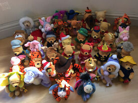 An assortment of 39 Winnie the Pooh & Friends Official Disney Beanies