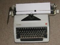 Portable manual typewriter (Olympia SM), 30 cm carriage, dust cover, brush and instruction booklet
