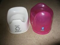 A Red/Pink Tippitoes Potty and a White BabyBjorn Potty