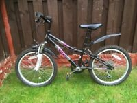 """Girls 20"""" bike like new with front suspension can deliver for a small charge"""