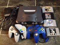 Nintendo 64 Console With 2 Controllers and 4 Games.