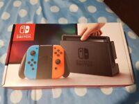 Nintendo Switch Neon + Mario Kart Deluxe