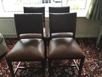 Dining chairs in brown leather