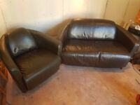 Unusual Sofa good condition , armchair and 2 seater, brown faux leather. Cowhide backs.