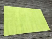 Small green rug