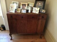 Dark wood sideboard with large cupboard space and two drawers