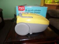 yellow bagged cylinder vacuum cleaner