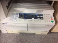 Printer plus photo copier suitable for a busy office .
