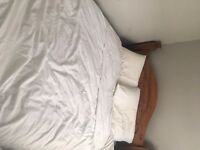 A great double bed and double mattress, double mattress, wooden wardrobe and IKEA blue sofa
