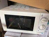 Microwave in good working condition for sale