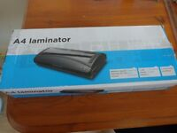 Cheap, good A4 laminator with some laminating pouches £10