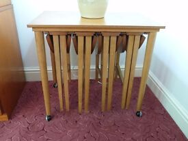 Trolley table with 4 tables stored underneath. In good condition