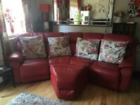 DFS Red Leather curved 4 seater settee with matching storage footstool
