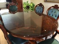 Solid dark wood dining table and 6 chairs