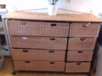 8 drawer wicker chest of drawers, made of cane and black cast iron, with built in castors