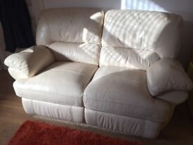 Cream leather two seater reclining sofa settee