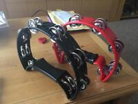 Two tambourines one red and one black as new.