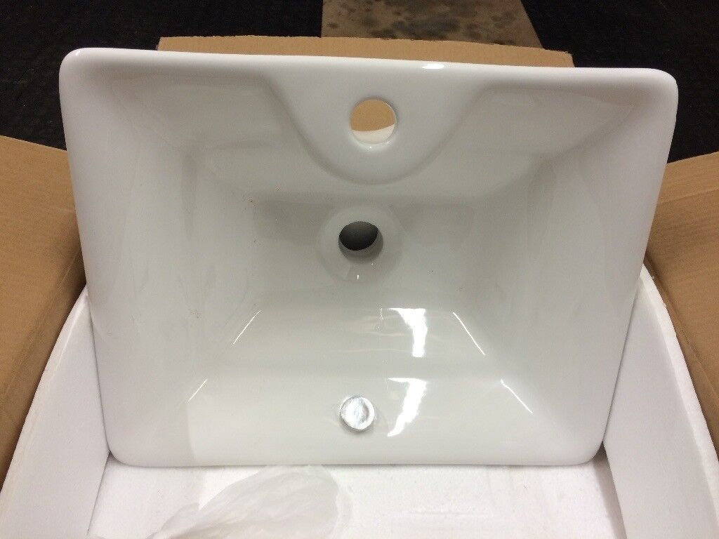 Ceramic table top sink and chrome bottle trap waste