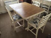 Wooden extendable dinning table and 4 chairs