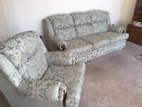 Teal and cream damask patterned sofa and armchair