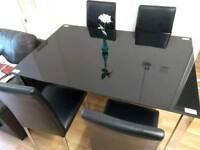 Lovely Glass dinning table with chairs