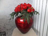 scarlet red heart shaped vase with flowers