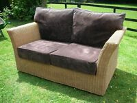 2 seater rattan style conservatory sofa with dark brown suedette seat covers