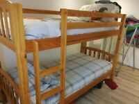 Wooden single bunk beds