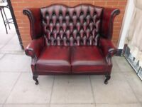 An Oxblood Red Leather Chesterfield Queen Ann Two Seater High Back Sofa