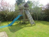 TP Kingswood climbing frame swings and slide and climbing wall abd monkey bars