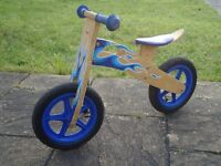 Wooden balance bike. In good condition