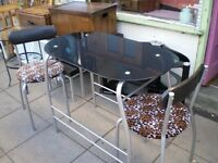 BLACK GLASS AND CROME BREAKFAST TABLE WITH TWO MATCHING CHAIRS