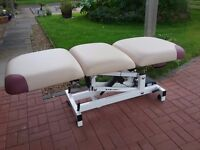 Multi positional hydraulic/electric therapy couch with arms &headrest. Makers Darley. Beige. V.G.C.