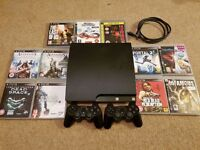 PS3 Slim 120Gb, Charcoal black console with 2 controllers and 11 Games