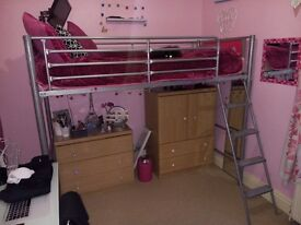 High Bed. Silver metal frame with pink header and footer inserts. Excludes mattress. Easy to asemble