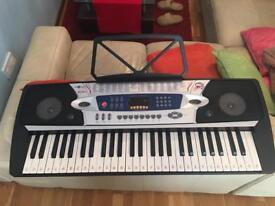 Keyboard with microphone and stand.