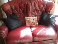 Pair of 2seater sofas light weight,high backs, in oxblood red leather .